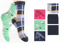 Childrens socks with boy`s and girl`s dessins separated in bunch